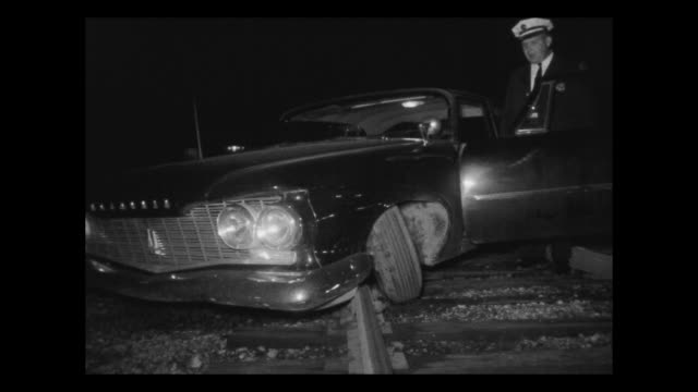 Car accident on railroad tracks / The automobile is completely destroyed when it collided with a train / The railway accident is a common vehicle...