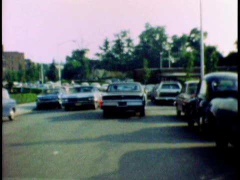 vidéos et rushes de 1970 t/l car pov along street lined with parked cars / riverdale, new york city, usa - 1970