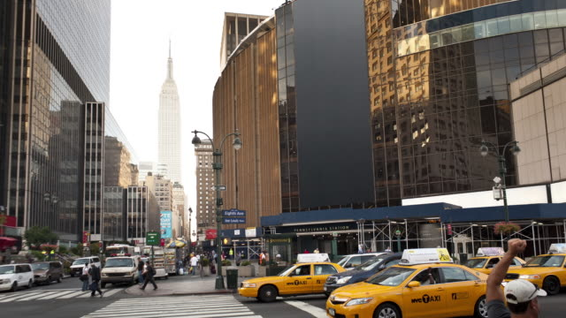 t/l ws car and pedestrian traffic at madison square garden / new york city, new york state, usa - yellow taxi stock videos & royalty-free footage