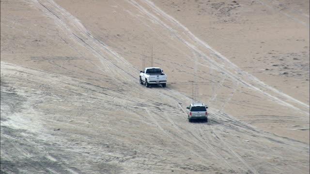 car and pickup on beach - aerial view - north carolina,  dare county,  united states - north carolina beach stock videos & royalty-free footage