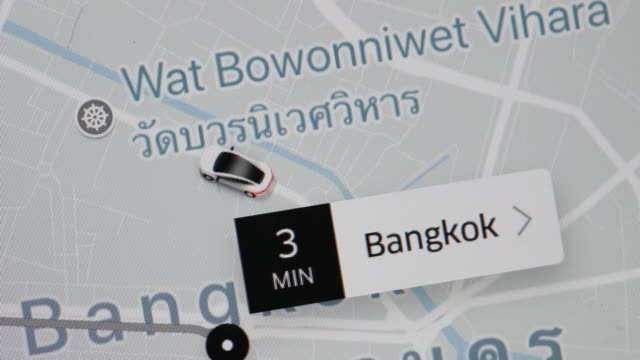 Car animations reveal location of various Uber vehicles on a map from the Uber Technologies Inc application in an arranged video taken in Bangkok...