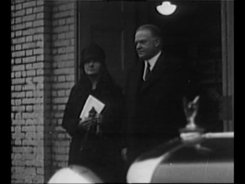 vídeos de stock e filmes b-roll de car approaches stops man decars opens door and us president herbert hoover decars with woman walks to building / hoover stands with physicist marie... - física