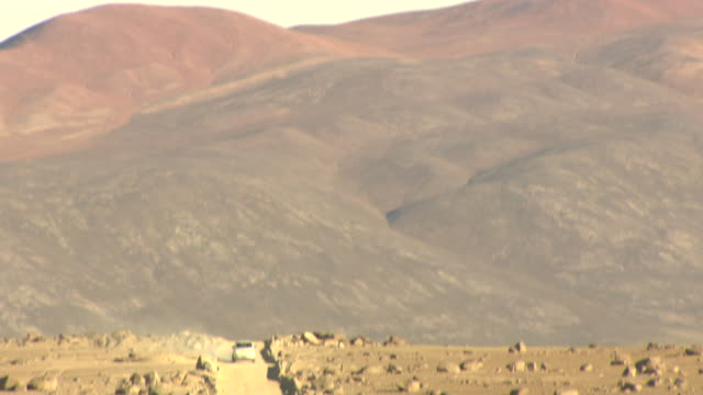 ms td car approaching on dusty road / paranal, atacama, chile - cerro paranal stock videos and b-roll footage
