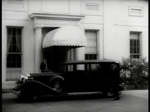 car at white house side doors int vs men lounging in lobby smoking us president franklin d roosevelt at desk w/ assistant papers ext vs cars in... - federal building stock videos & royalty-free footage
