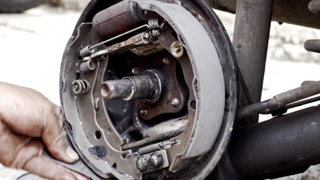 car band brakes repair and maintenance - hispanic man sanding brake bands - maintenance engineer stock videos & royalty-free footage