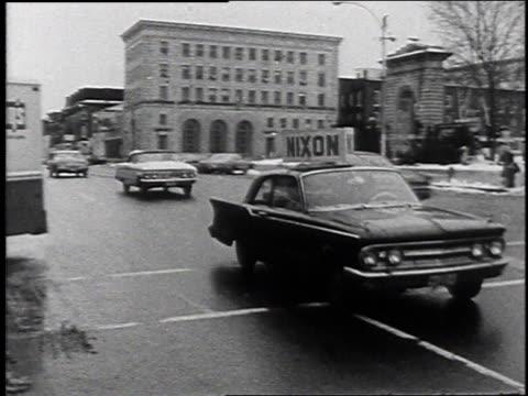 vidéos et rushes de car bearing nixon sign driving past building bearing romney for president banner / laconia, new hampshire, united states - eugene j. mccarthy