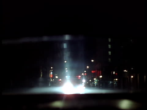 a car being chased by a police car with flashing lights. - police car stock videos and b-roll footage