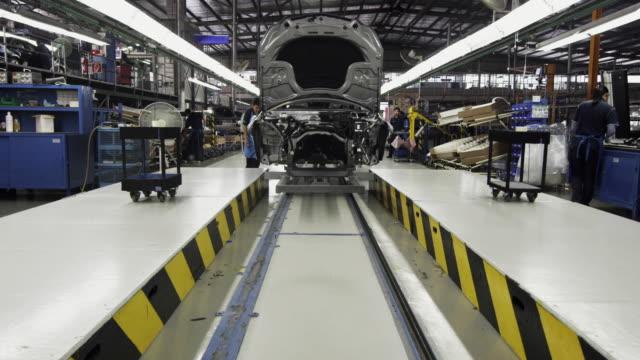 WS Car body being moved down production assembly line / Samut Prakan, Bang Muang Mai, Thailand