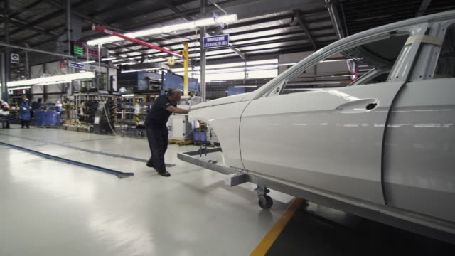 ws pan car body being moved onto assembly line / samut prakan, bang muang mai, thailand - 2k resolution stock videos and b-roll footage