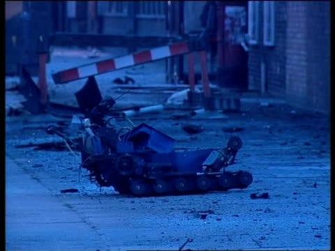 car bomb at bbc sky cars parked outside badly damaged entrance to television centre ms remains of wheelbarrow bomb disposal robot in street ms debris... - wheelbarrow stock videos & royalty-free footage