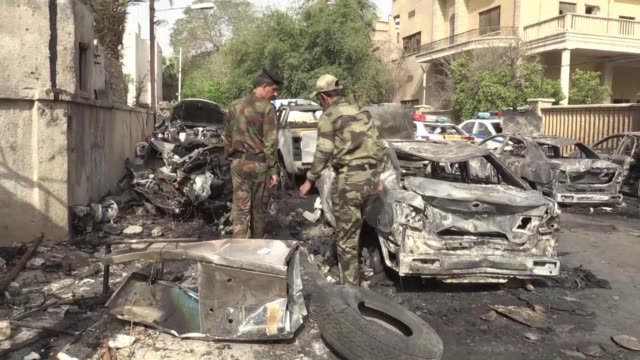 vídeos de stock, filmes e b-roll de a car bomb attack on a traffic police compound in central baghdad kills at least three people and wounds seven - iraque