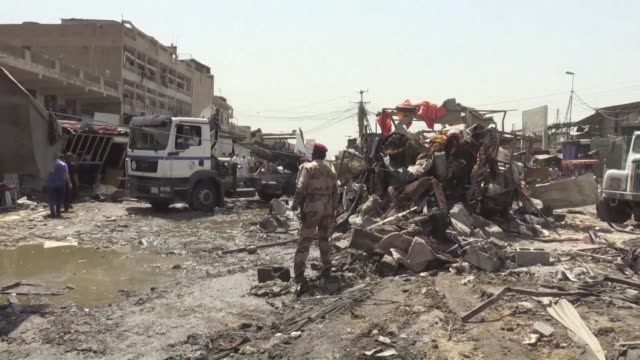 vídeos de stock, filmes e b-roll de a car bomb in the iraqi capital's shiite majority district of sadr city on monday killed 11 people and wounded another 26 security officials and... - iraque