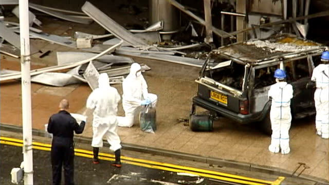 glasgow airport police forensics officers collecting evidence from scene - glasgow international airport stock videos & royalty-free footage