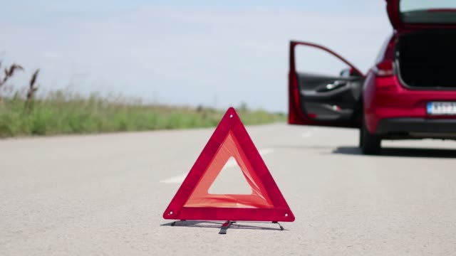 car breakdown on the road - road warning sign stock videos & royalty-free footage