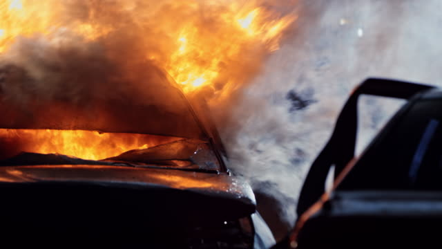 car burning at the scene of a car crash at night - burnt stock videos & royalty-free footage