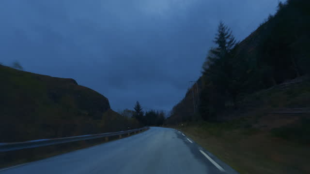 pov car by the fjords of norway: twilight night driving - car point of view stock videos & royalty-free footage