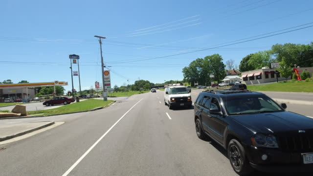 stockvideo's en b-roll-footage met car camera point of view of commercial signs along the road amid the 2020 global coronavirus pandemic in usa - winkelbord