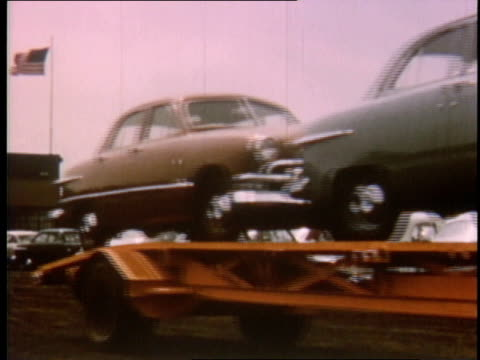 1951 montage car carriers driving through city / detroit, michigan, united states - 1951 stock videos & royalty-free footage