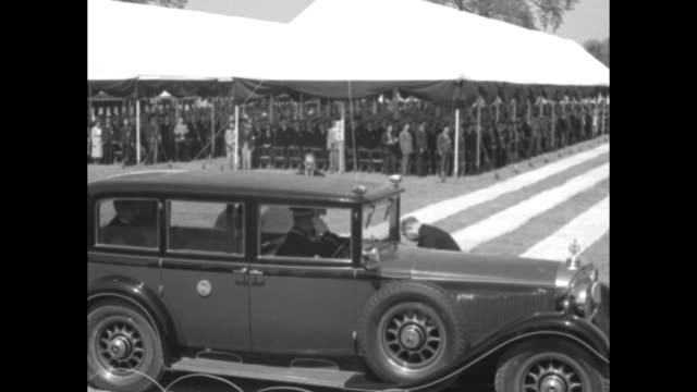 car carrying emperor hirohito and wife empress nagako pulls up near large awning with people under it as the royal couple attends memorial service... - pacific war stock videos & royalty-free footage