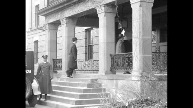 vidéos et rushes de car carrying grace coolidge drives past camera / grace gets out of car and walks up steps to entrance of hospital / shot of exterior of hospital /... - northampton