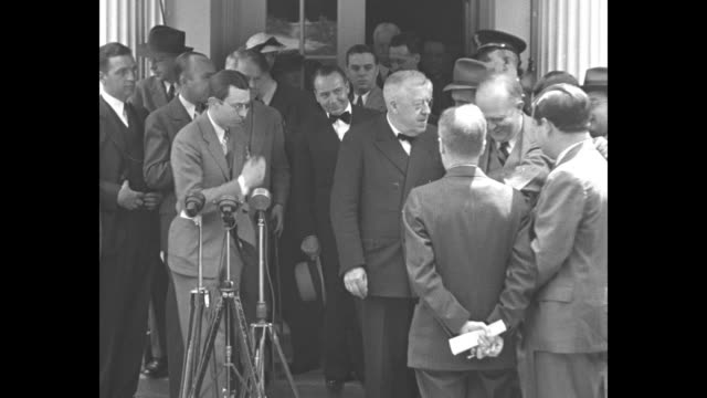 car carrying hugo eckener, manager of german airship company, pulls up at steps to entrance of white house and us military officer opens door, man... - seguire attività che richiede movimento video stock e b–roll