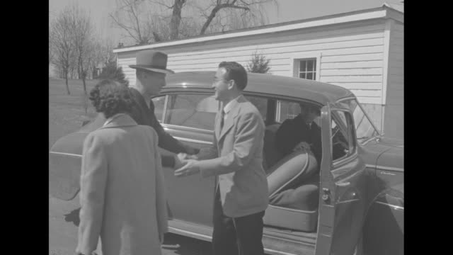 car carrying japanese workers arrives at farm sam rice former major league baseball player standing beside sign waiting for them sign reads sam... - east asian ethnicity stock videos & royalty-free footage