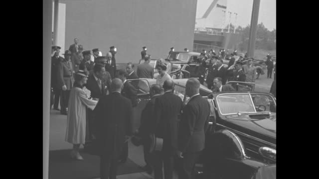 car carrying king george vi and wife queen elizabeth pulls up / george and queen get out of car and are greeted by dignitaries / they walk across... - ボーイスカウト連盟点の映像素材/bロール