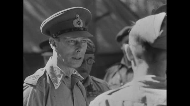 car carrying king george vi drives down tripoli street with british soldiers lining street raising hats in salute as he passes by / car rolls by... - military exercise stock videos & royalty-free footage
