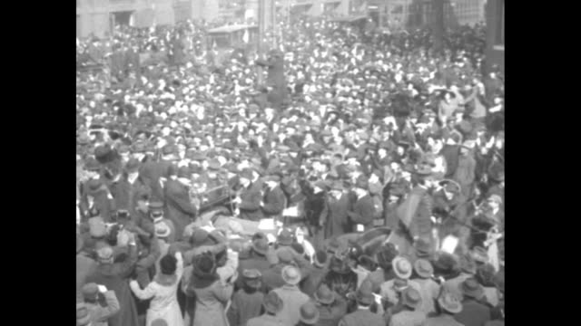 stockvideo's en b-roll-footage met car carrying pres woodrow wilson driving through huge crowd / two shots of crowd milling about / note exact month/day not known - woodrow wilson