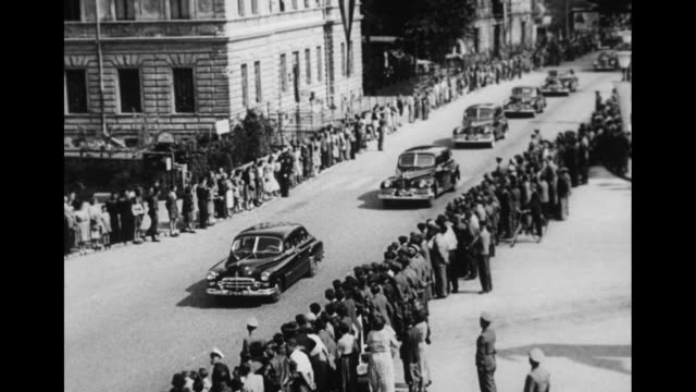 car carrying soviet foreign minister molotov driving away from airport past camera / motorcade driving down street crowds on either side watching /... - vyacheslav m. molotov stock videos and b-roll footage