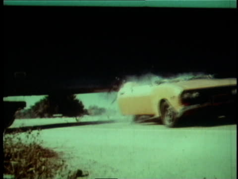 stockvideo's en b-roll-footage met 1978 montage car chase scene ending with crash / los angeles county, california, united states - kleine groep dingen