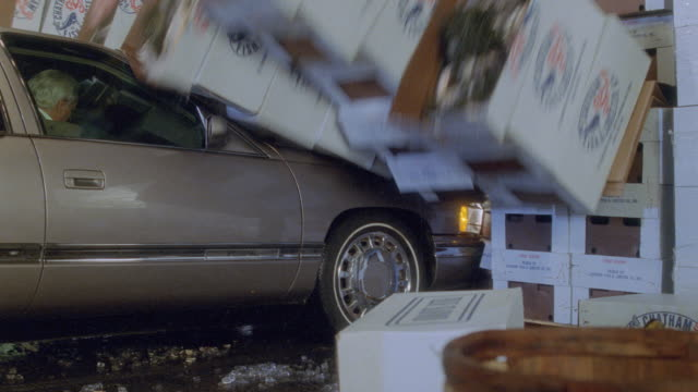 a car collides with boxes in a fish market. - stunt stock videos & royalty-free footage