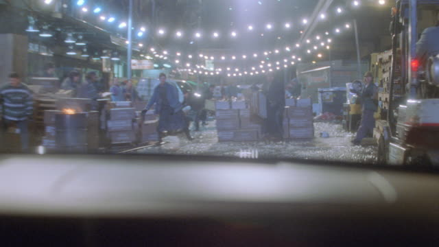 a car collides with boxes in a fish market. - entrare in collisione video stock e b–roll