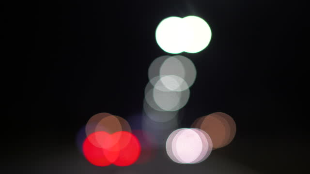 car pov of colorful bokeh - night stock videos & royalty-free footage