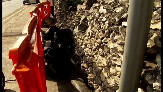 car crash in croydon kills woman; england: london: croydon: ext rubble behind barricade at wall destroyed by car collision - barricade stock videos & royalty-free footage