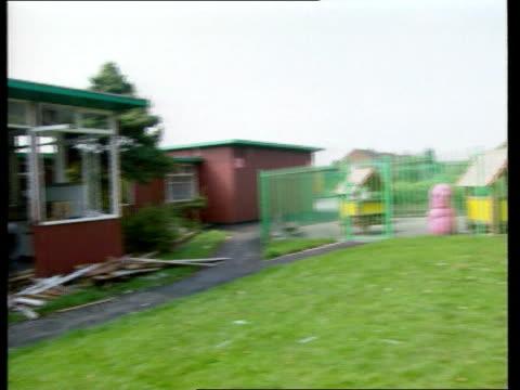 vidéos et rushes de lancashire atherton damaged fence at green hall school pan classroom wall wrecked by car debris tilt order ref bsp060999026 - lancashire