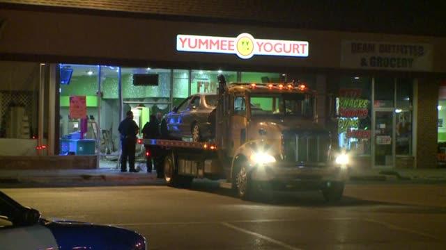 car crashes into yummee yogurt car on flatbed after crash on august 07 2013 in dallas texas - frozen yogurt stock videos and b-roll footage