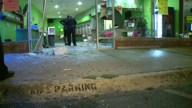 car crashes into yummee yogurt police at car crash scene on august 07 2013 in dallas texas - frozen yogurt stock videos and b-roll footage