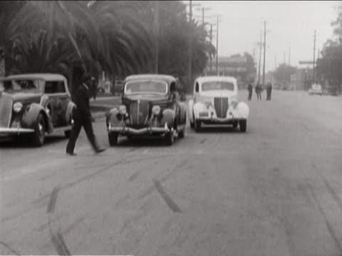 vídeos de stock, filmes e b-roll de car crashing into walking man - vintage car