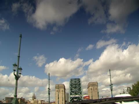 a car crosses the tyne bridge. - tyne bridge stock videos & royalty-free footage