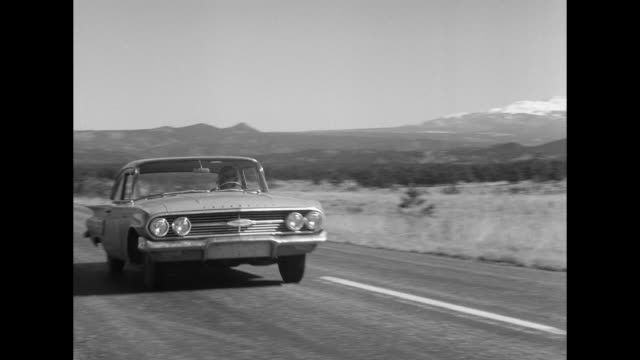 1962 a car crosses the utah state line - us state border stock videos & royalty-free footage