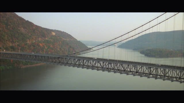 aerial ws pan ts car crossing bridge - letterbox format stock videos & royalty-free footage