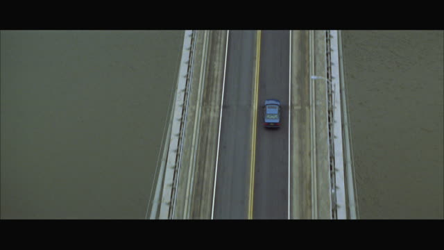 aerial ws ts car crossing bridge - letterbox format stock videos & royalty-free footage