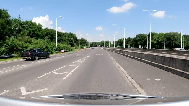 4k pov car crossing humber bridge toll in summer minimal to no traffic, kingston upon hull, united kingdom - suspension bridge stock videos & royalty-free footage