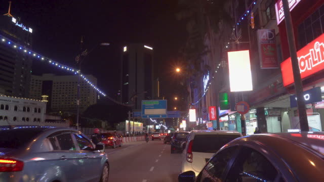 car crossing shop lots at night - southeast asia stock videos & royalty-free footage