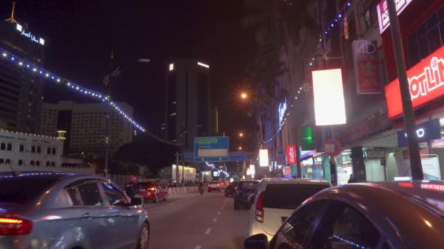 car crossing shop lots at night - sydostasien bildbanksvideor och videomaterial från bakom kulisserna