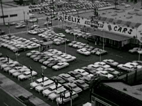 Car dealer lot LS Parked cars in long row ready or sale new used VS Signs 'Cash for Clean Cars' 'Credit City' 'Cash for Cars Drivein' '100%...
