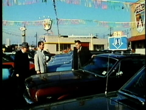 montage, car dealership, 1960's, detroit, michigan, usa - autohandlung stock-videos und b-roll-filmmaterial