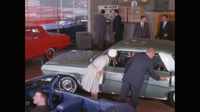 ms car dealership, salesman showing car to family / united states - consumerism stock videos and b-roll footage