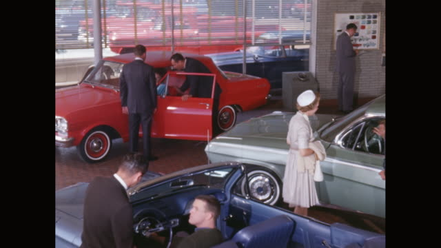 ms car dealership, salesmen showing cars to customers / united states - verkaufsargument stock-videos und b-roll-filmmaterial
